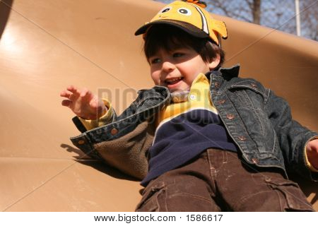 Happy Young Boy Sliding