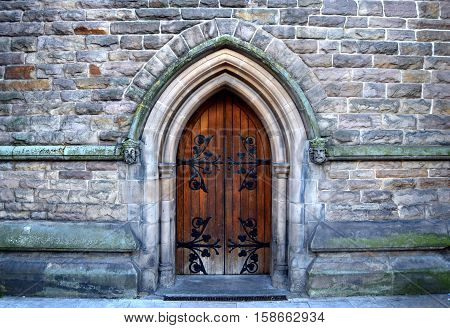 Beautiful architecture of the rear entrance into the old church in city center of Birmingham , United Kingdom