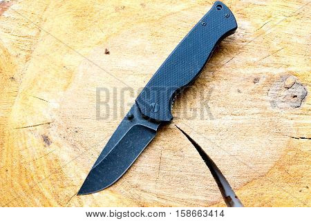 Pocket knife with a black blade. Casual knife.