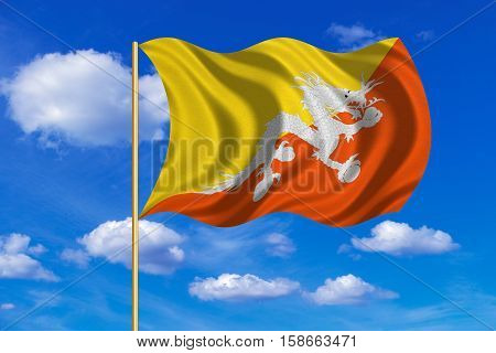 Bhutanese national official flag. Patriotic symbol banner element background. Correct colors. Flag of Bhutan on flagpole waving in the wind blue sky background. Fabric texture. 3D rendered illustration