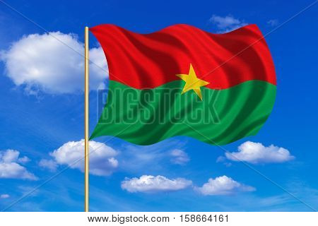 Burkina Faso national official flag. African patriotic symbol banner element background. Correct colors. Flag of Burkina Faso on flagpole waving in the wind blue sky background. Fabric texture. 3D rendered illustration