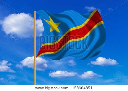DR Congo national official flag. African patriotic symbol banner element. Correct colors. Flag of Democratic Republic of the Congo on flagpole waving in the wind blue sky background. Fabric texture. 3D rendered illustration