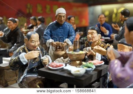 BEIJING - FEBRUARY 24: Chinese figures in restaurant at famous Qianmen pedestrian commercial street in Beijing, China, February 24, 2016.