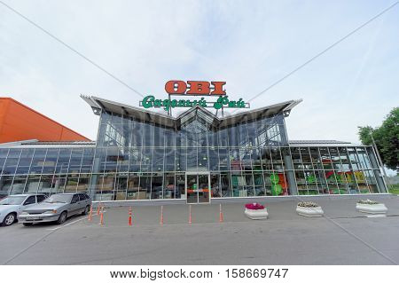 Nizhny Novgorod, Russia. - July 8.2016. OBI store sells tools and materials with parked cars.