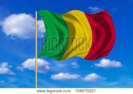 Malian national official flag. African patriotic symbol banner element background. Correct colors. Flag of Mali on flagpole waving in the wind blue sky background. Fabric texture. 3D rendered illustration