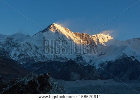 Cho Oyu Mountain Ridge Lit Up By The Sunset Lights. Beautiful Sunset High In The Himalayan Mountains