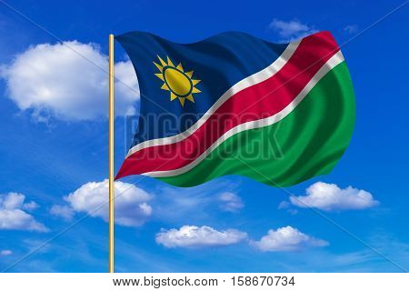 Namibian national official flag. African patriotic symbol banner element background. Correct colors. Flag of Namibia on flagpole waving in the wind blue sky background. Fabric texture. 3D rendered illustration