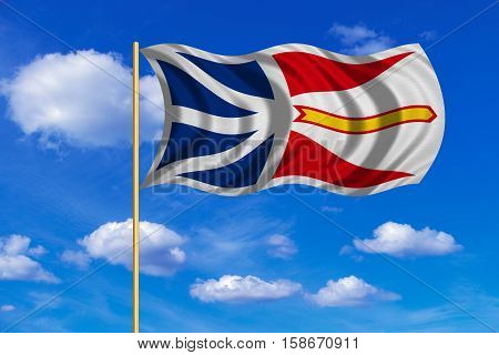 Canadian provincial NL patriotic element and official symbol. Canada banner. Correct colors. Flag of the Canadian province of Newfoundland and Labrador on flagpole waving in wind blue sky background. 3D rendered illustration