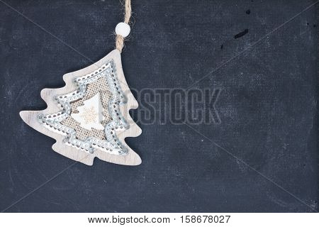 Decorative christmas tree on black wooden background