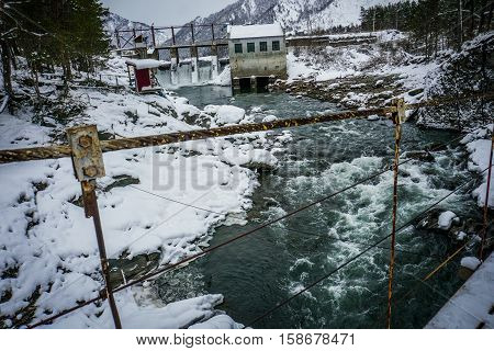 hydro-electric power station in Katun river on Chemal, Altai, Siberia at winter