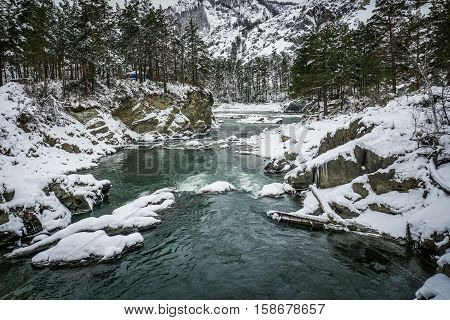 Mountain river Katun, Altai, Russia. A winter scenic.