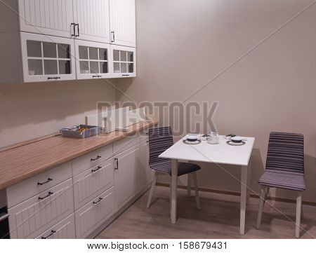 Elegant kitchen furniture: table chairs and sideboard. Interior