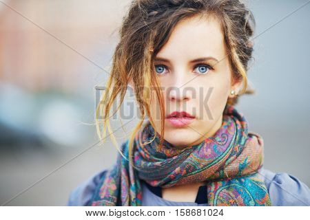Wonderful portrait of a cute charming girl Slav on blurred background in the street in autumn, closeup