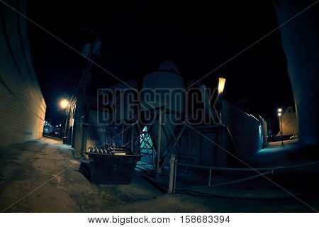 Dark industrial urban city alley at night