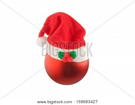 Christmas ball with Santa hat isolated over white. Christmas and New Year theme.