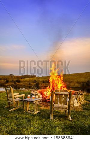 Bonfire in a firepit at sunset in Central Kentucky countryside