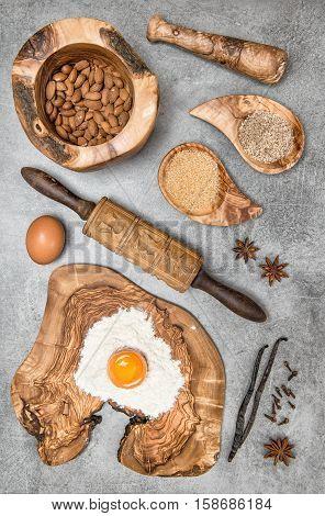 Food background. Baking utensils and ingredients on kitchen table. Eggs flour sugar almond vanilla