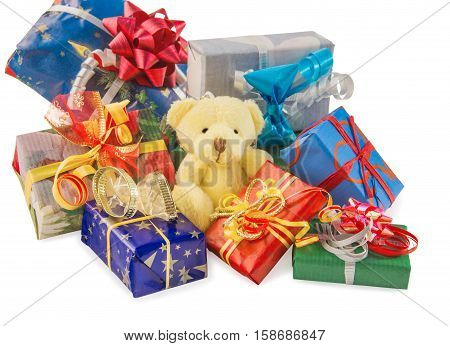 Teddy bear classic soft toy sitting with heap of gift boxes isolated over white. For Christmas New Year birthday wedding anniversary etc. Front view. Horizontal.