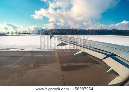 Sky and airport lane as seen through window of an aircraft, river and sky as seen through window of an aircraft.