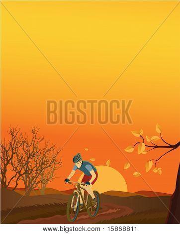 Autumn landscape with a mountain biker.