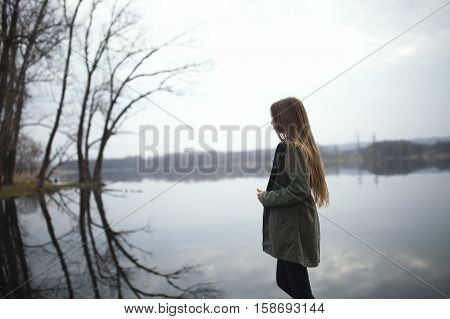 Red-haired girl with freckles walking with Husky dog in autumn forest. Other pet dog Husky
