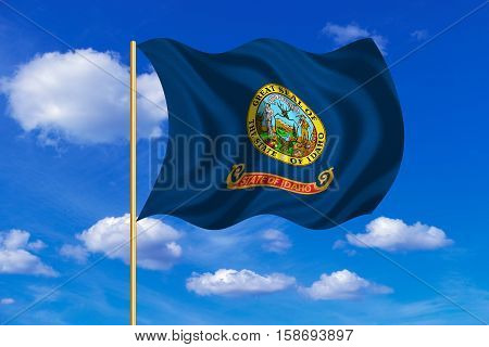 Flag of the US state of Idaho. American patriotic element. USA banner. United States of America symbol. Idahoan official flag on flagpole waving in the wind blue sky background. Fabric texture. 3D rendered illustration