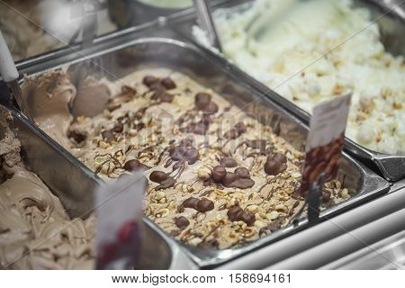 Genuine Italian ice - Variety of yummy ice creams under shopping window