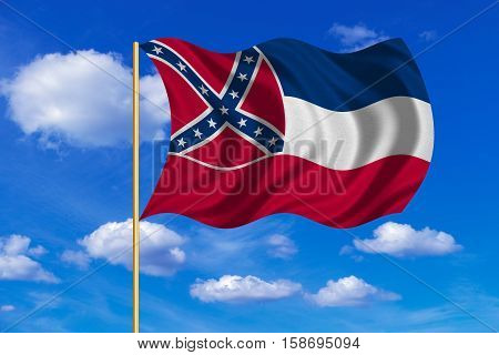 Flag of the US state of Mississippi. American patriotic element. USA banner. United States of America symbol. Mississippian official flag on flagpole waving in the wind sky background. Fabric texture. 3D rendered illustration
