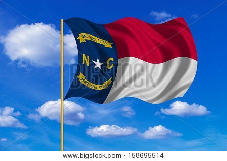 Flag of the US state of North Carolina. American patriotic element. USA banner. United States of America symbol. North Carolinian official flag waving in the wind blue sky background. Fabric texture. 3D rendered illustration