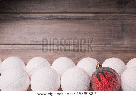 Christmas still life with balls on the wooden background. Copy space