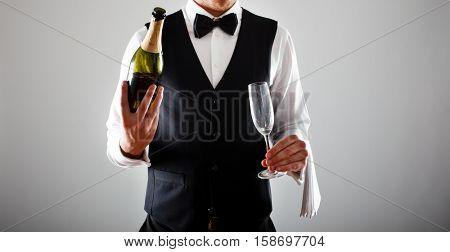 Portrait of an handsome waiter at work
