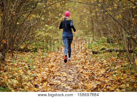 Young woman jogging in morning