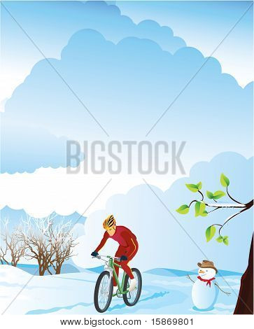 Winter landscape with a mountain biker.