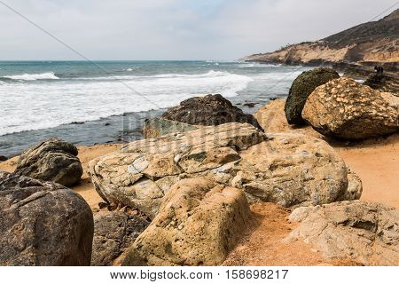 Giant boulders and cliffs at the Point Loma tidepools in San Diego, California.