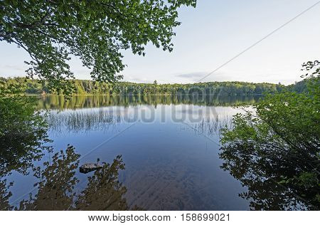 Late Afternoon on a Mirror lake in Porcupine Mountains State Park in Michigan