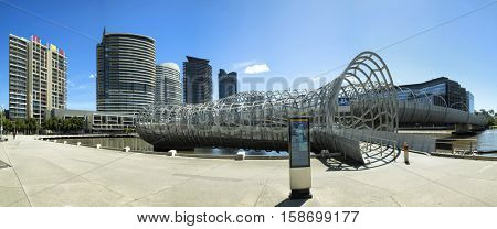 MELBOURNE, AUSTRALIA - OCTOBER 19, 2016:  Webb Bridge in Melbourne is a pedestrian/cycle bridge over the Yarra River and a part of a public art project Docklands area. Collaboration with Robert Owen.