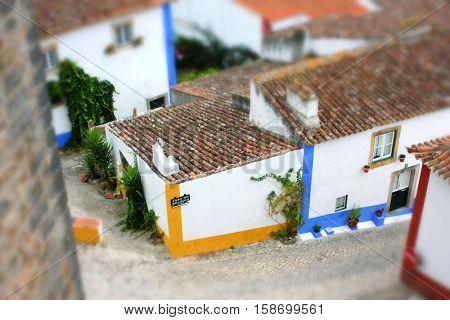 Miniature or tilt-shift effect on Obidos, medieval village in Portugal.