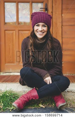 Beautiful young woman outdoors in a cold winter day