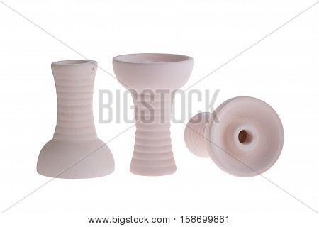 hookah bowl for tobacco shisha three figured ceramic products, pottery with long curly legs, three clay bowls arranged in a row, three beige clay vessels with curly legs, one vessel stands right and second reversed and third lays