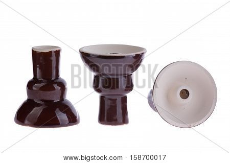 hookah bowl for tobacco shisha three dark-brown glazed ceramic bowls, clay vessels in a row, brown glazed figured pottery, one clay product stands right and another reversed and third lays