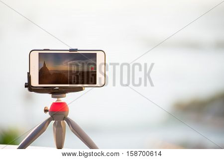Closeup phone shooting time lab sunrise view