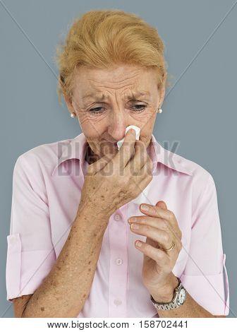 Senior Women Blowing Nose Concept