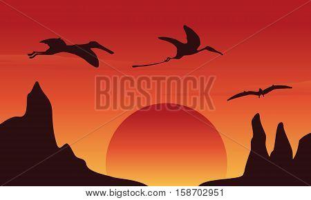 Silhouette of dinosaur pterodactyl at sunset scenery illustration
