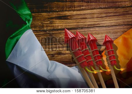 3D Rockets for fireworks against irish flag on table