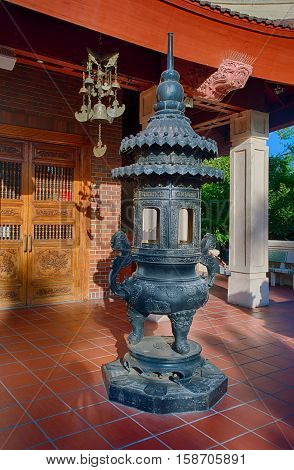 Giant bronze incense burner in buddhist temple. Also used to burn ghost money as a part of Chinese tradition on holidays to venerate the deceased and also at funerals to make sure that the spirits have plenty of good things in the afterlife.