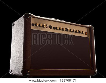 Guitar amplifier in black studio. shot from below