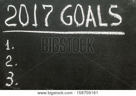 2017 Goals message written on blackboard with copyspace for text