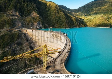 The Enguri hydroelectric power station HES. The Jvari Reservoir next to Inguri Dam surrounded by mountains Upper Svaneti Georgia. Second highest concrete arch dam in the world. Jvari location.