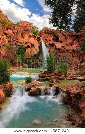 Beautiful Havasu Falls surrounded by red rocks, Supai, Arizona, USA