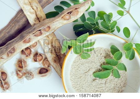 Moringa Leaf, Seed And Powder On White Background